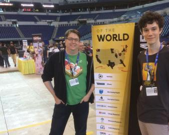 Shawn and Ben pose with the Megagame Coalition's map of megagame groups around the country and the world.
